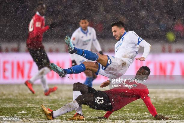 Ihlas Bebou of Hannover 96 and Lukas Rupp of 1899 Hoffenheim battle for the ball during the Bundesliga match between Hannover 96 and TSG 1899...
