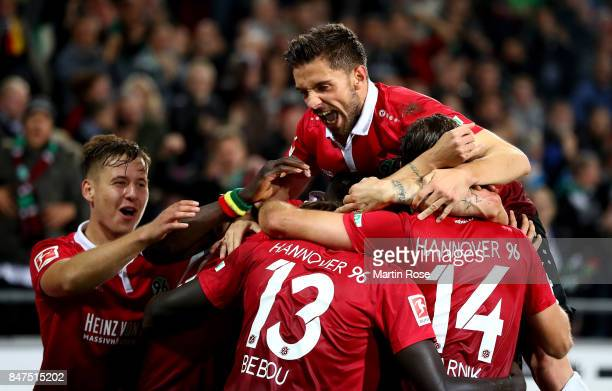 Ihlas Bebou of Hannover celebrate with his team mates after he scores the 2nd goal during the Bundesliga match between Hannover 96 and Hamburger SV...