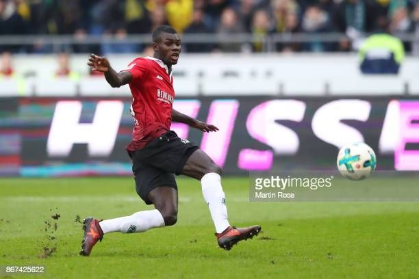 Ihlas Bebou of Hannover shoots to score his teams second goal to make it 21 during the Bundesliga match between Hannover 96 and Borussia Dortmund at...