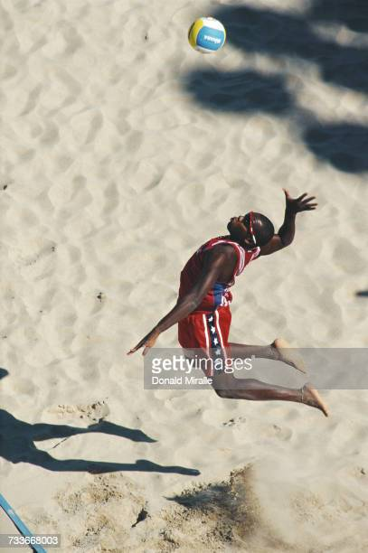 Ihosvany Chambers Hernandez of Cuba serves against Brazil during their Beach Volleyball bronze medal match at the XIII Pan American Games on 3 August...