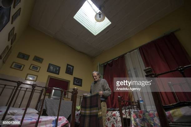 Ihsan Adnan Ercan 60yearold Turkish man covers a duvet in his room at the 'Yeni Sukran Hotel' that has been welcoming its guests for 112 years in...