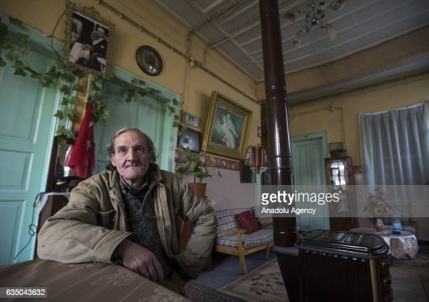 Ihsan Adnan Ercan 60yearold Turkish man poses at the lobby of 'Yeni Sukran Hotel' that has been welcoming its guests for 112 years in Izmir Turkey on...