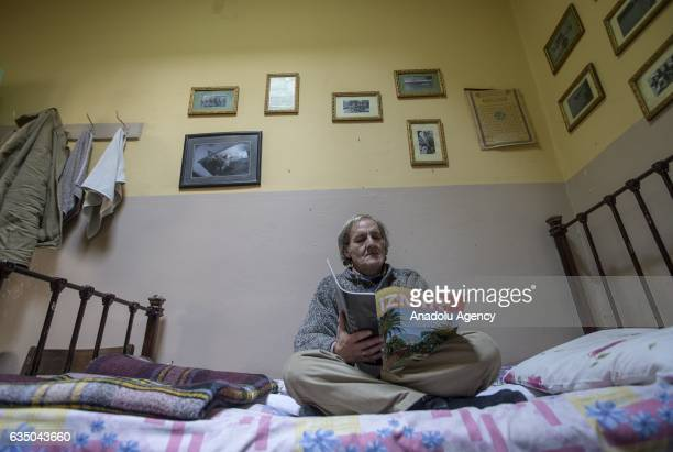 Ihsan Adnan Ercan 60yearold Turkish man reads a magazine in his room at the 'Yeni Sukran Hotel' that has been welcoming its guests for 112 years in...