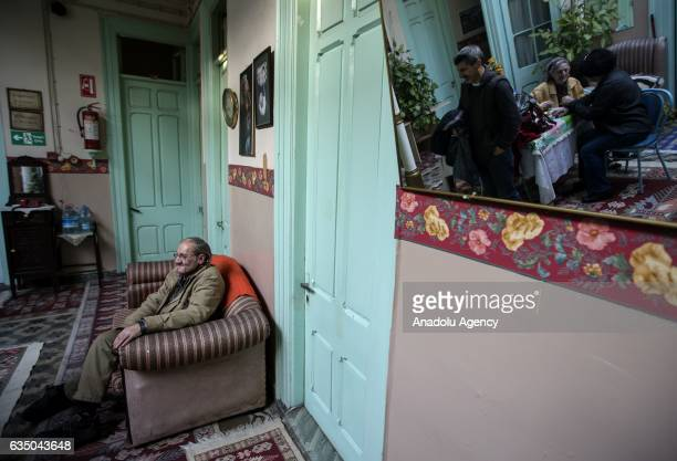 Ihsan Adnan Ercan 60yearold Turkish man sits at the lobby of 'Yeni Sukran Hotel' that has been welcoming its guests for 112 years in Izmir Turkey on...