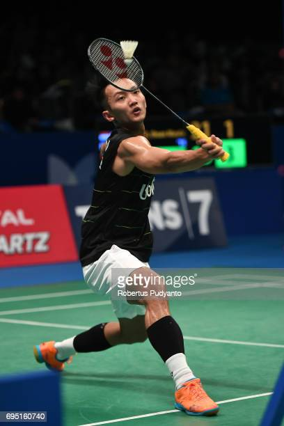 Ihsan Maulana Mustofa of Indonesia competes against Wei Nan of Hong Kong during Mens single qualification round match of the BCA Indonesia Open Super...