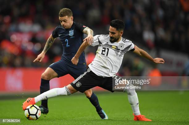 IIkay Gundogan of Germany and Kieran Trippier of England battle for possession during the International friendly match between England and Germany at...