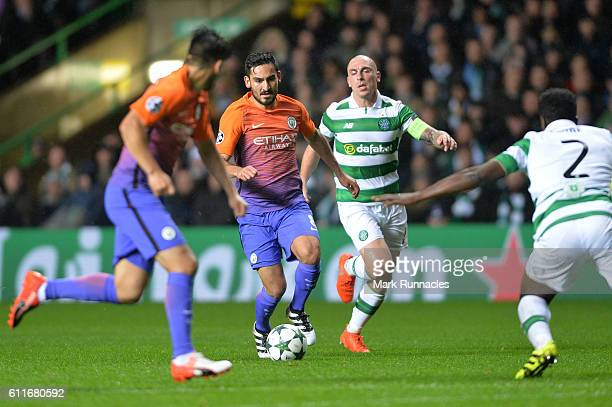 IIkay Gundogan of Manchester City takes on Scott Brown and Kolo Toure of Celtic during the UEFA Champions League match between Celtic FC and...