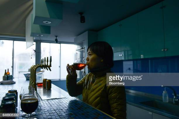 Iino Mariko a public relations employee for YoHo Brewing Co tastes a Yona Yona Ale at the company's brewery in Saku Nagano Prefecture Japan on Friday...