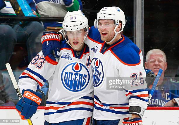 Iiro Pakarinen and Ryan NugentHopkins of the Edmonton Oilers celebrate a goal against the Vancouver Canucks during their NHL game at Rogers Arena...