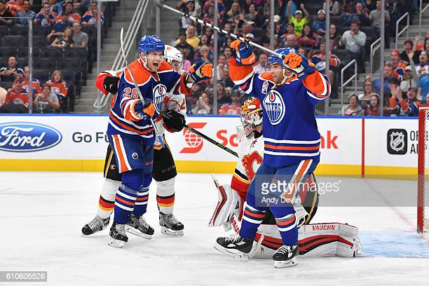 Iiro Pakarinen and Ryan Vesce of the Edmonton Oilers celebrate after scoring a goal on Niklas Backstrom of the Calgary Flames on September 26 2016 at...