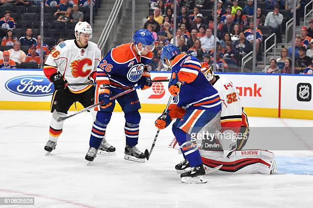 Iiro Pakarinen and Ryan Vesce of the Edmonton Oilers score a goal against Niklas Backstrom of the Calgary Flames on September 26 2016 at Rogers Place...