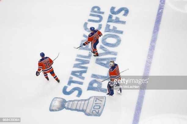Iiro Pakarinen Connor McDavid and goalie Cam Talbot of the Edmonton Oilers warm up against the San Jose Sharks in Game One of the Western Conference...