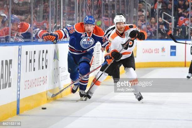 Iiro Pakarinen of the Edmonton Oilers battles for the puck against Claude Giroux of the Philadelphia Flyers on February 16 2017 at Rogers Place in...