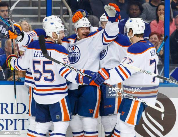 Iiro Pakarinen of the Edmonton Oilers celebrates his goal with teammates Mark Letestu Matt Hendricks and Oscar Klefbom against the Tampa Bay...