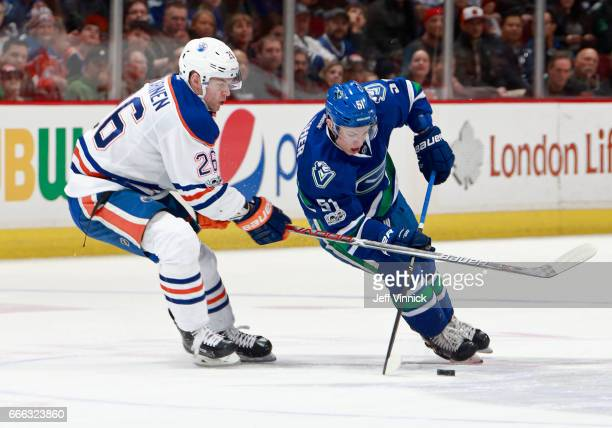 Iiro Pakarinen of the Edmonton Oilers checks Troy Stecher of the Vancouver Canucks during their NHL game at Rogers Arena April 8 2017 in Vancouver...