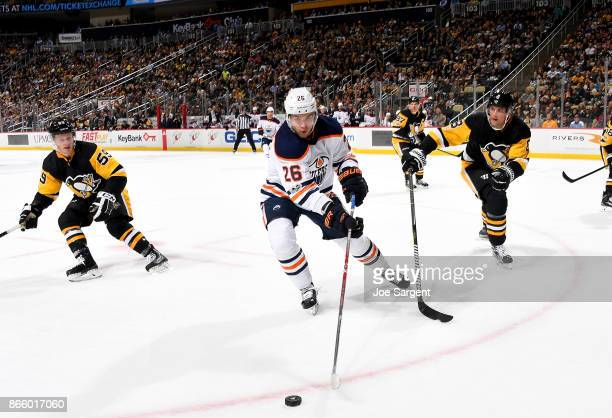 Iiro Pakarinen of the Edmonton Oilers handles the puck against Brian Dumoulin of the Pittsburgh Penguins at PPG Paints Arena on October 24 2017 in...