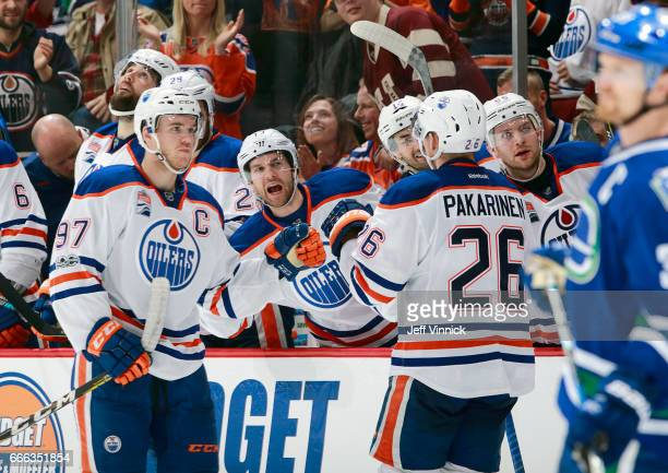 Iiro Pakarinen of the Edmonton Oilers is congratulated by teammate Connor McDavid after scoring during their NHL game against the Vancouver Canucks...