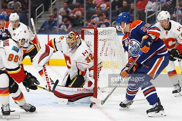 Iiro Pakarinen of the Edmonton Oilers looks for a shot against goaltender Jon Gillies of the Calgary Flames during a preseason NHL game on September...