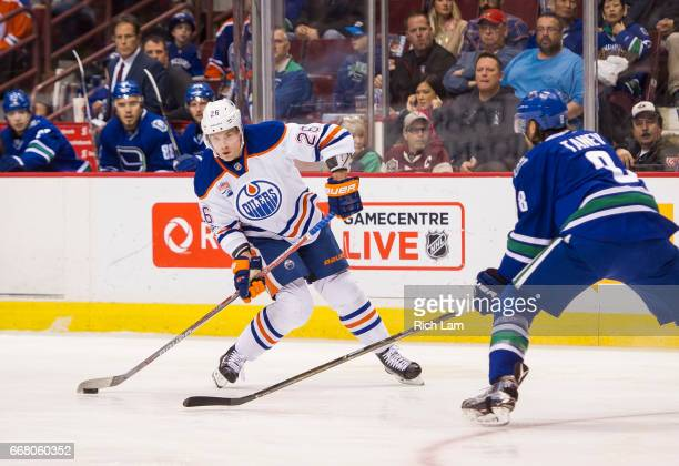 Iiro Pakarinen of the Edmonton Oilers tries to get a shot on net through Chris Tanev of the Vancouver Canucks in NHL action on April 8 2017 at Rogers...