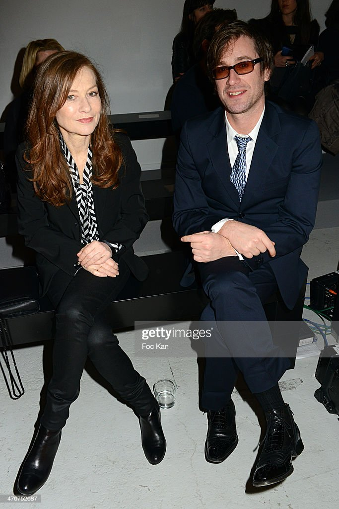 IIsabelle Huppert and Thomas Dutronc attend the Agnes B show as part of the Paris Fashion Week Womenswear Fall/Winter 20142015 at Palais de Tokyo on...