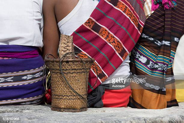 Ikat cloth woven locally on women spectators at a ceremony Sangliat Dol village Yamdena island Tanimbar archipelago Maluku Indonesia