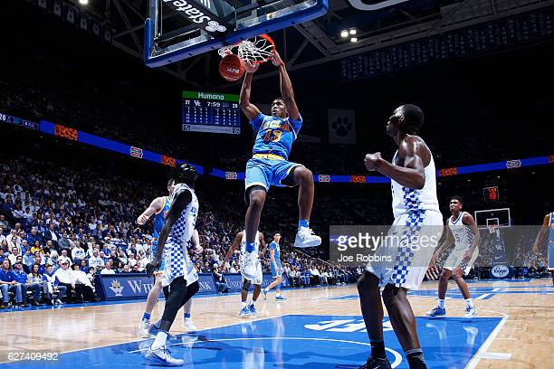 Ike Anigbogu of the UCLA Bruins dunks against the Kentucky Wildcats in the first half of the game at Rupp Arena on December 3 2016 in Lexington...