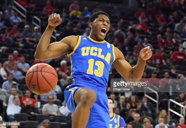 Ike Anigbogu of the UCLA Bruins reacts after dunking against the Arizona Wildcats during a semifinal game of the Pac12 Basketball Tournament at...