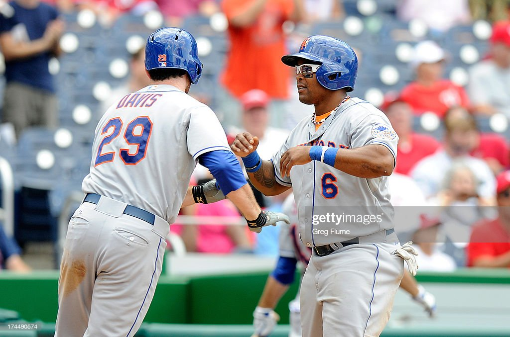 <a gi-track='captionPersonalityLinkClicked' href=/galleries/search?phrase=Ike+Davis&family=editorial&specificpeople=2349664 ng-click='$event.stopPropagation()'>Ike Davis</a> #29 of the New York Mets celebrates with <a gi-track='captionPersonalityLinkClicked' href=/galleries/search?phrase=Marlon+Byrd&family=editorial&specificpeople=217377 ng-click='$event.stopPropagation()'>Marlon Byrd</a> #6 after hitting a home run in the ninth inning against the Washington Nationals at Nationals Park on July 26, 2013 in Washington, DC. New York Won the game 11-0.