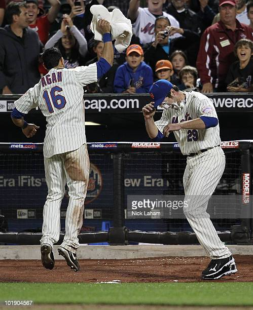 Ike Davis of the New York Mets is given a whipped cream pie by teammate Angel Pagan after hitting a solo home run in the eleventh inning to win the...