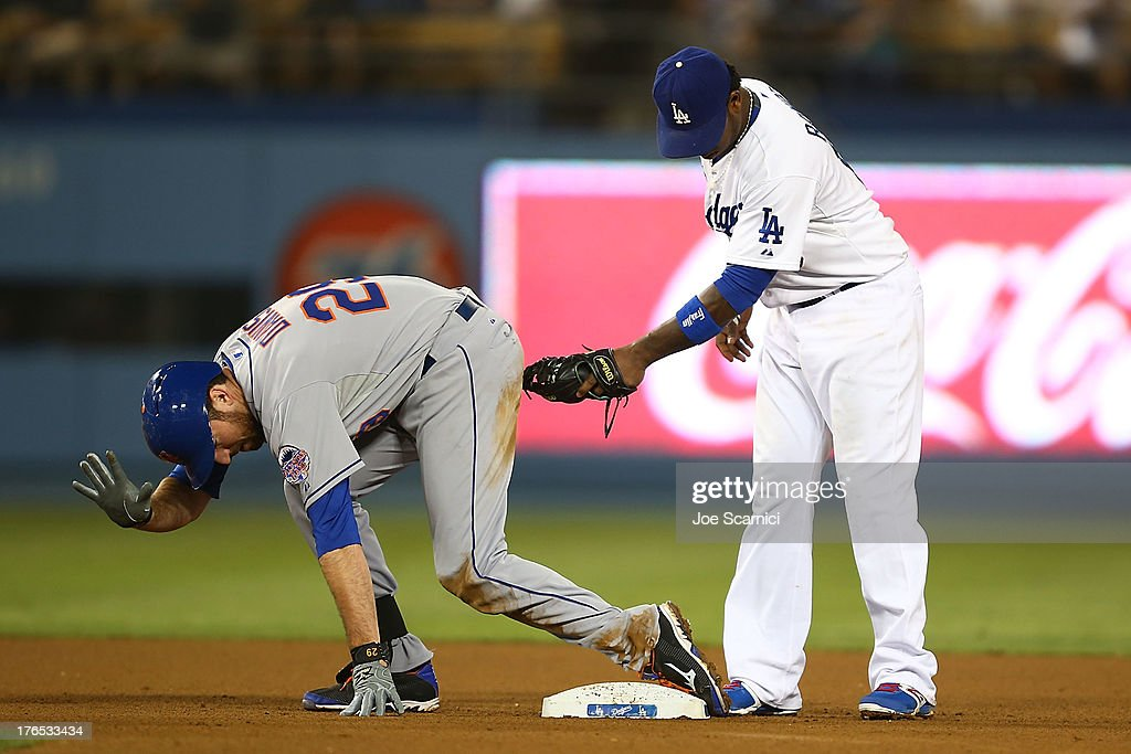 <a gi-track='captionPersonalityLinkClicked' href=/galleries/search?phrase=Ike+Davis&family=editorial&specificpeople=2349664 ng-click='$event.stopPropagation()'>Ike Davis</a> #29 of the New York Mets is safe on second after hitting a double on the ground to right field in the eighth inning against the Los Angeles Dodgers as <a gi-track='captionPersonalityLinkClicked' href=/galleries/search?phrase=Hanley+Ramirez&family=editorial&specificpeople=538406 ng-click='$event.stopPropagation()'>Hanley Ramirez</a> #13 of the Los Angeles Dodgers tags for good measure at Dodger Stadium on August 14, 2013 in Los Angeles, California.