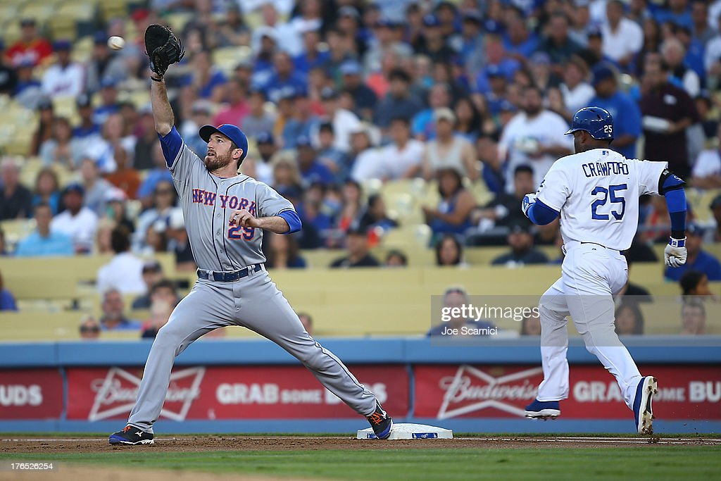 <a gi-track='captionPersonalityLinkClicked' href=/galleries/search?phrase=Ike+Davis&family=editorial&specificpeople=2349664 ng-click='$event.stopPropagation()'>Ike Davis</a> #29 of the New York Mets makes a catch at first base to tag out Carl Crawford #25 of the Los Angeles Dodgers in the second inning at Dodger Stadium on August 14, 2013 in Los Angeles, California.