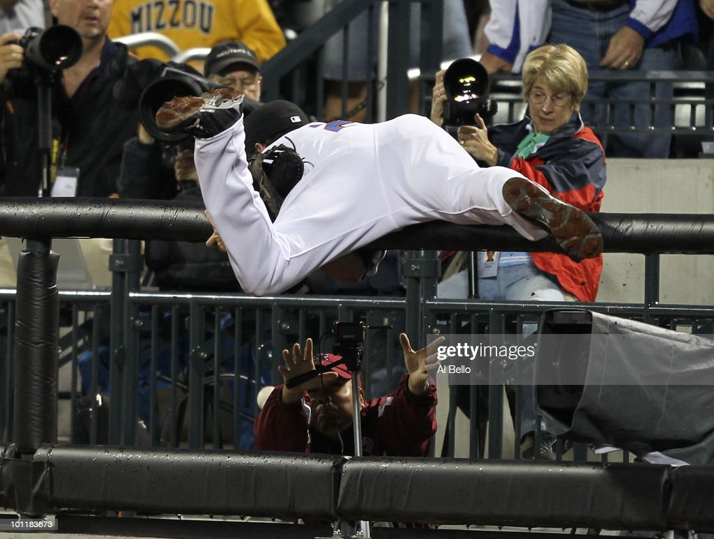 <a gi-track='captionPersonalityLinkClicked' href=/galleries/search?phrase=Ike+Davis&family=editorial&specificpeople=2349664 ng-click='$event.stopPropagation()'>Ike Davis</a> #29 of the New York Mets misses a foul ball against the Philadelphia Phillies during their game on May 27, 2010 at Citi Field in the Flushing neighborhood of the Queens borough of New York City.
