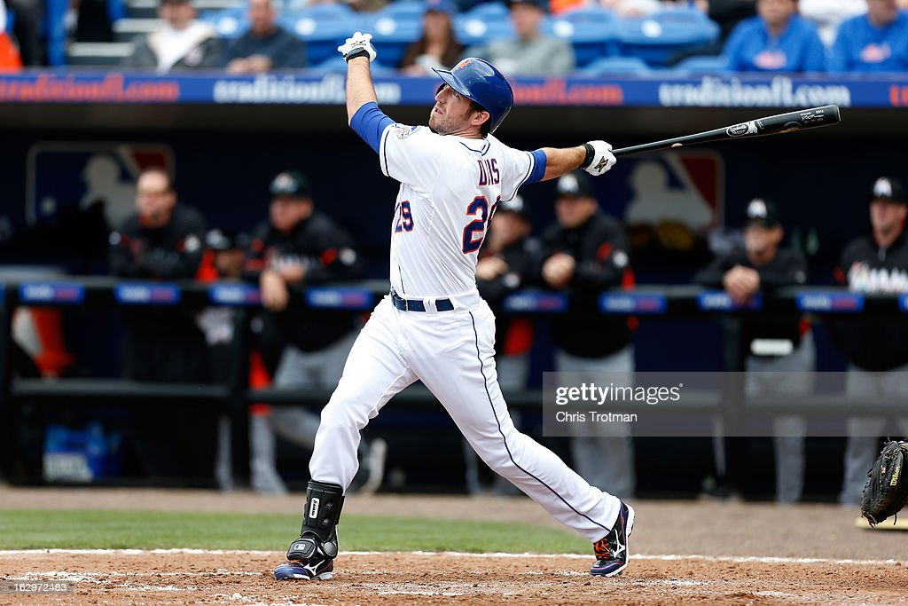 Ike Davis #29 of the New York Mets pops the ball up against the Miami Marlins at Tradition Field on March 2, 2013 in Port St. Lucie, Florida.