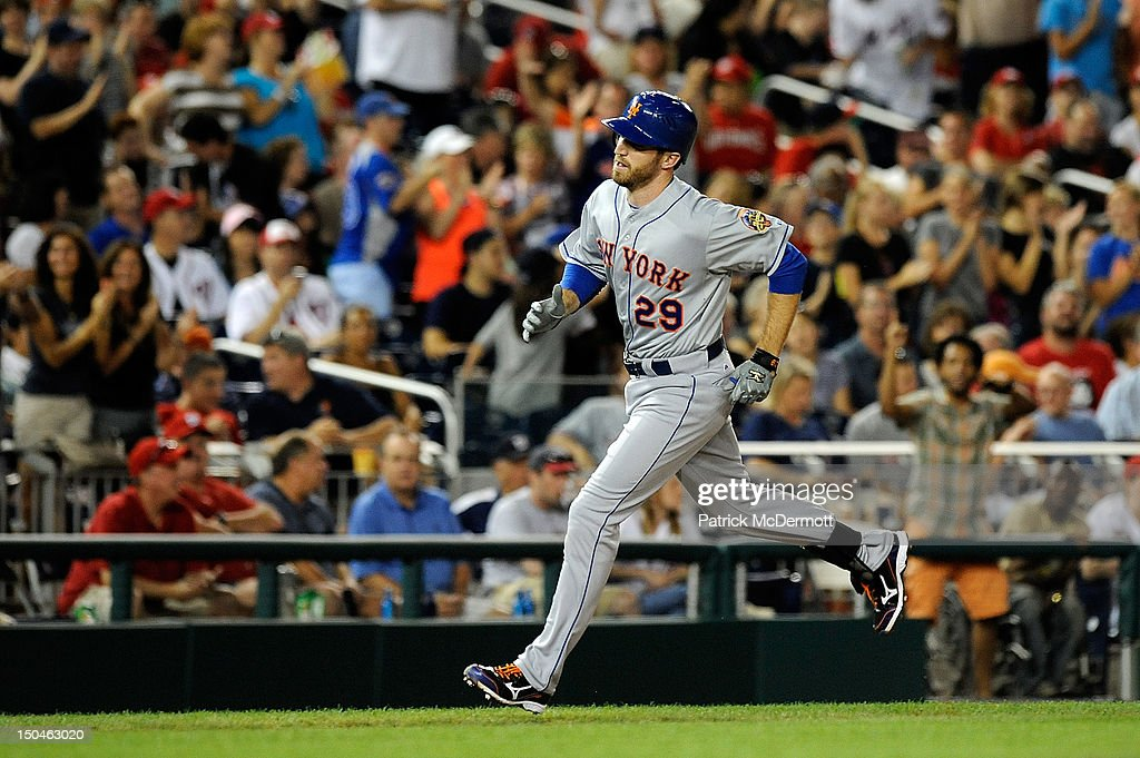 <a gi-track='captionPersonalityLinkClicked' href=/galleries/search?phrase=Ike+Davis&family=editorial&specificpeople=2349664 ng-click='$event.stopPropagation()'>Ike Davis</a> #29 of the New York Mets rounds third base after hitting a two run home run in the seventh inning against the Washington Nationals at Nationals Park on August 18, 2012 in Washington, DC.