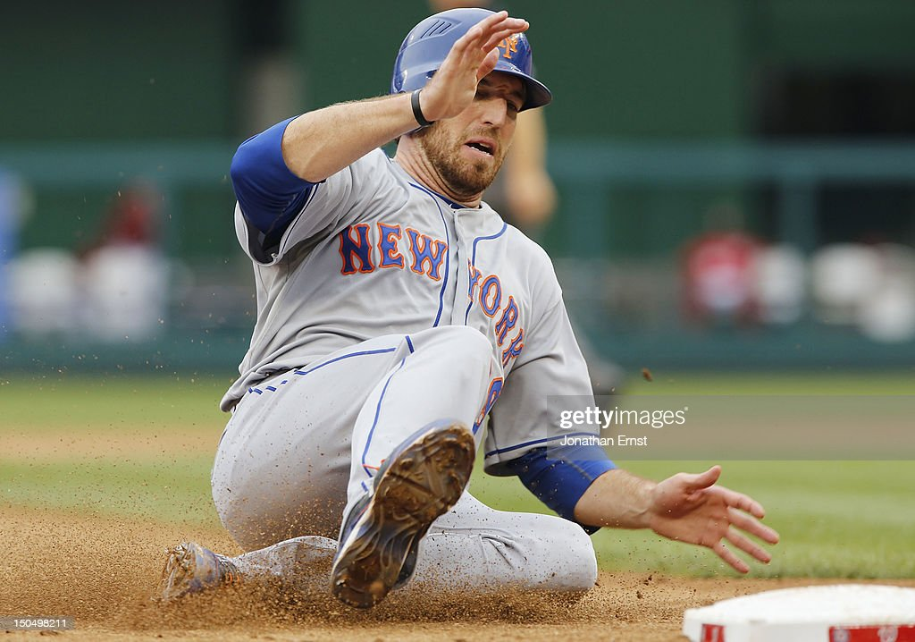 <a gi-track='captionPersonalityLinkClicked' href=/galleries/search?phrase=Ike+Davis&family=editorial&specificpeople=2349664 ng-click='$event.stopPropagation()'>Ike Davis</a> #29 of the New York Mets slides safely into third on a fly ball by teammate Ronny Cedeno (not pictured) during the sixth inning against the Washington Nationals at Nationals Park on August 19, 2012 in Washington, DC.