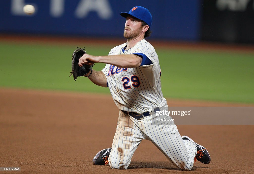 <a gi-track='captionPersonalityLinkClicked' href=/galleries/search?phrase=Ike+Davis&family=editorial&specificpeople=2349664 ng-click='$event.stopPropagation()'>Ike Davis</a> #29 of the New York Mets throws from his knees after making a diving catch to complete the out in the eighth inning against the Philadelphia Phillies at Citi Field on July 3, 2012 in the Flushing neighborhood of the Queens borough of New York City.