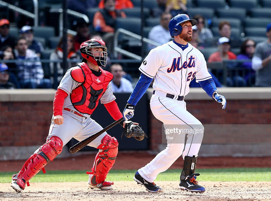 <a gi-track='captionPersonalityLinkClicked' href=/galleries/search?phrase=Ike+Davis&family=editorial&specificpeople=2349664 ng-click='$event.stopPropagation()'>Ike Davis</a> #29 of the New York Mets watches his walk off grand slam in the bottom of the ninth inning as Tucker Barnhart #16 of the Cincinnati Reds defends on April 5, 2014 at Citi Field in the Flushing neighborhood of the Queens borough of New York City.The New York Mets defeated the Cincinnati Reds 6-3.