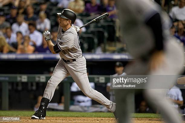 Ike Davis of the New York Yankees hits an eighth inning RBI single against the Colorado Rockies during a regular season interleague game at Coors...