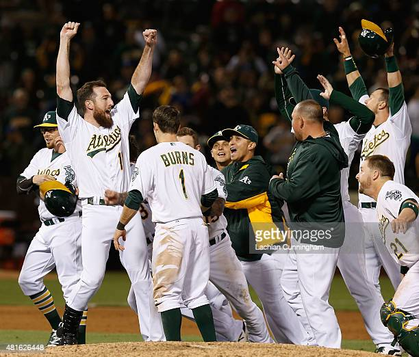 Ike Davis of the Oakland Athletics celebrates a win after an official review in the tenth inning against the Toronto Blue Jays at Oco Coliseum on...
