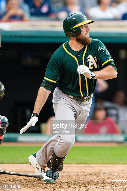 Ike Davis of the Oakland Athletics hits an RBI double during the seventh inning against the Cleveland Indians at Progressive Field on July 11 2015 in...