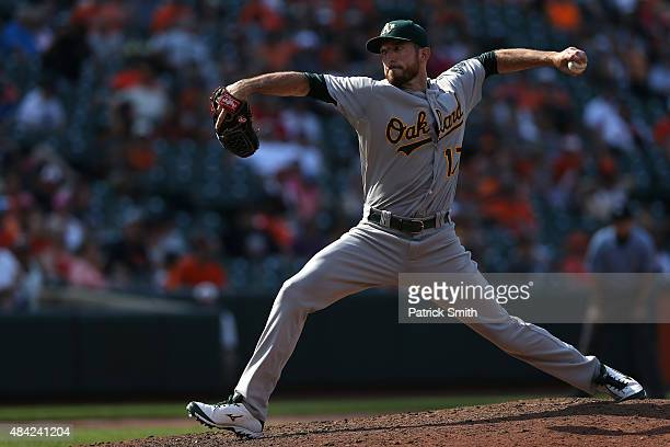 Ike Davis of the Oakland Athletics pitches in the eighth inning against the Baltimore Orioles at Oriole Park at Camden Yards on August 16 2015 in...