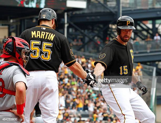 Ike Davis of the Pittsburgh Pirates celebrates with Russell Martin after hitting a two run home run in the second inning against the St Louis...