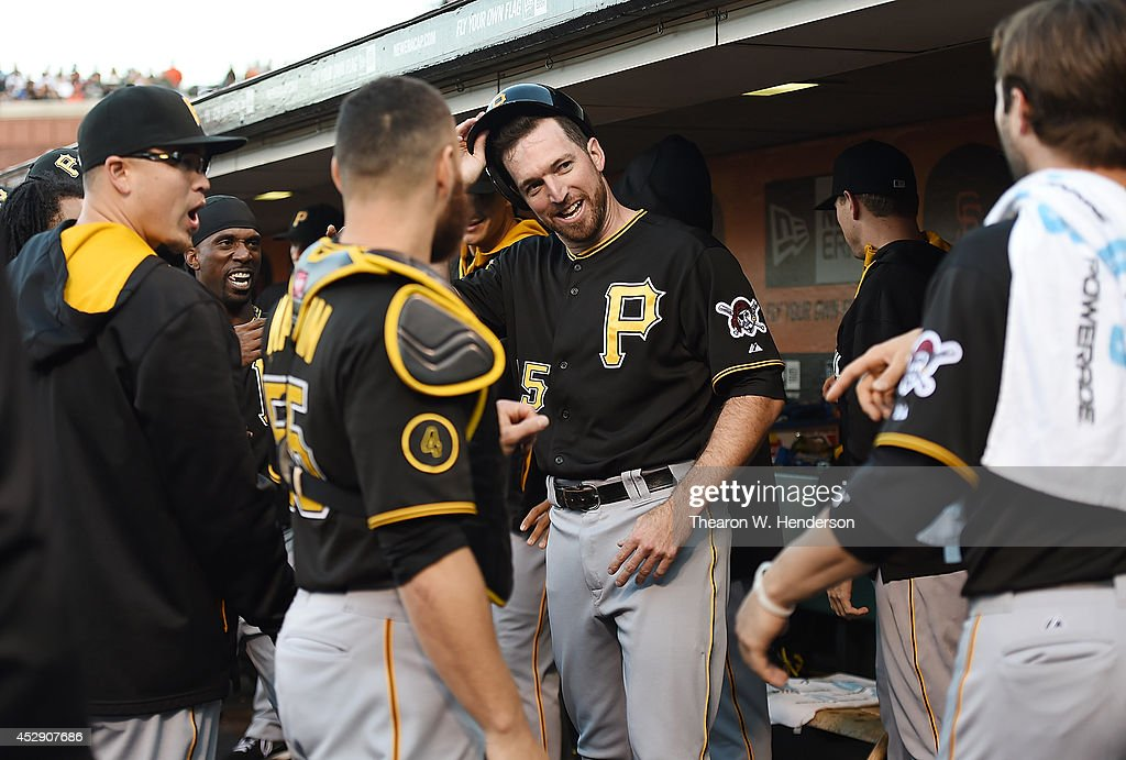 <a gi-track='captionPersonalityLinkClicked' href=/galleries/search?phrase=Ike+Davis&family=editorial&specificpeople=2349664 ng-click='$event.stopPropagation()'>Ike Davis</a> #15 of the Pittsburgh Pirates is congratulated by teammates after he scored against the San Francisco Giants in the top of the second inning at AT&T Park on July 29, 2014 in San Francisco, California. Davis scored on a two-run homer by Travis Snider #23 (not pictured).