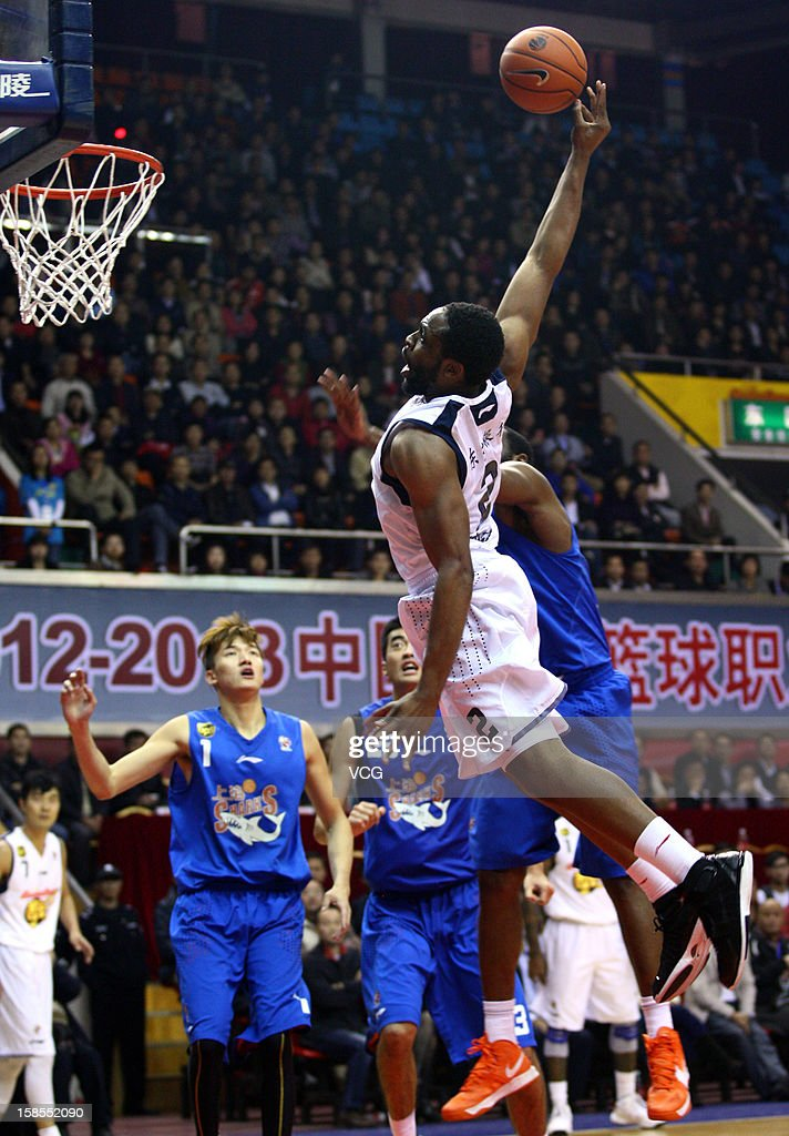 <a gi-track='captionPersonalityLinkClicked' href=/galleries/search?phrase=Ike+Diogu&family=editorial&specificpeople=556338 ng-click='$event.stopPropagation()'>Ike Diogu</a> #2 of Guangdong Southern Tigers dunks during the 11th round of the CBA 12/13 game against Shanghai Sharks at Dongguan Stadium on December 18, 2012 in Donggang, China.