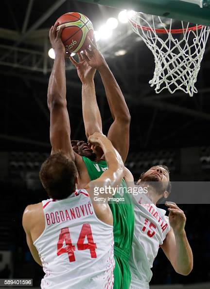 Ike Diogu of Nigeria battles Bojan Bogdanovic and Miro Bilan of Croatia for a rebound during the preliminary round game at the Rio 2016 Olympic Games...