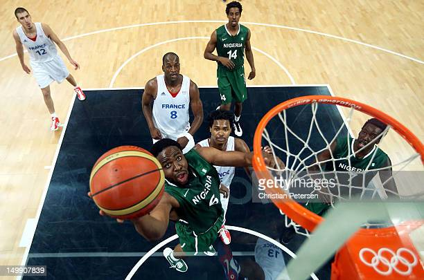 Ike Diogu of Nigeria drives for a shot attempt in the second half against France during the Men's Basketball Preliminary Round match on Day 10 of the...