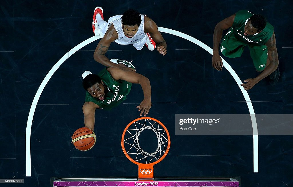 <a gi-track='captionPersonalityLinkClicked' href=/galleries/search?phrase=Ike+Diogu&family=editorial&specificpeople=556338 ng-click='$event.stopPropagation()'>Ike Diogu</a> of Nigeria drives for a shot attempt in the second half against <a gi-track='captionPersonalityLinkClicked' href=/galleries/search?phrase=Mickael+Gelabale&family=editorial&specificpeople=700549 ng-click='$event.stopPropagation()'>Mickael Gelabale</a> #15 of France during the Men's Basketball Preliminary Round match on Day 10 of the London 2012 Olympic Games at the Basketball Arena on August 6, 2012 in London, England. France won 79-73.