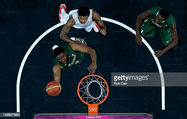 Ike Diogu of Nigeria drives for a shot attempt in the second half against Mickael Gelabale of France during the Men's Basketball Preliminary Round...