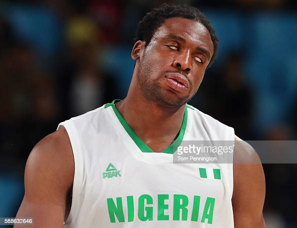 Ike Diogu of Nigeria reacts after being called for foul against Felipe Reyes of Spain during the Men's Basketball Preliminary Round Group B Nigeria...