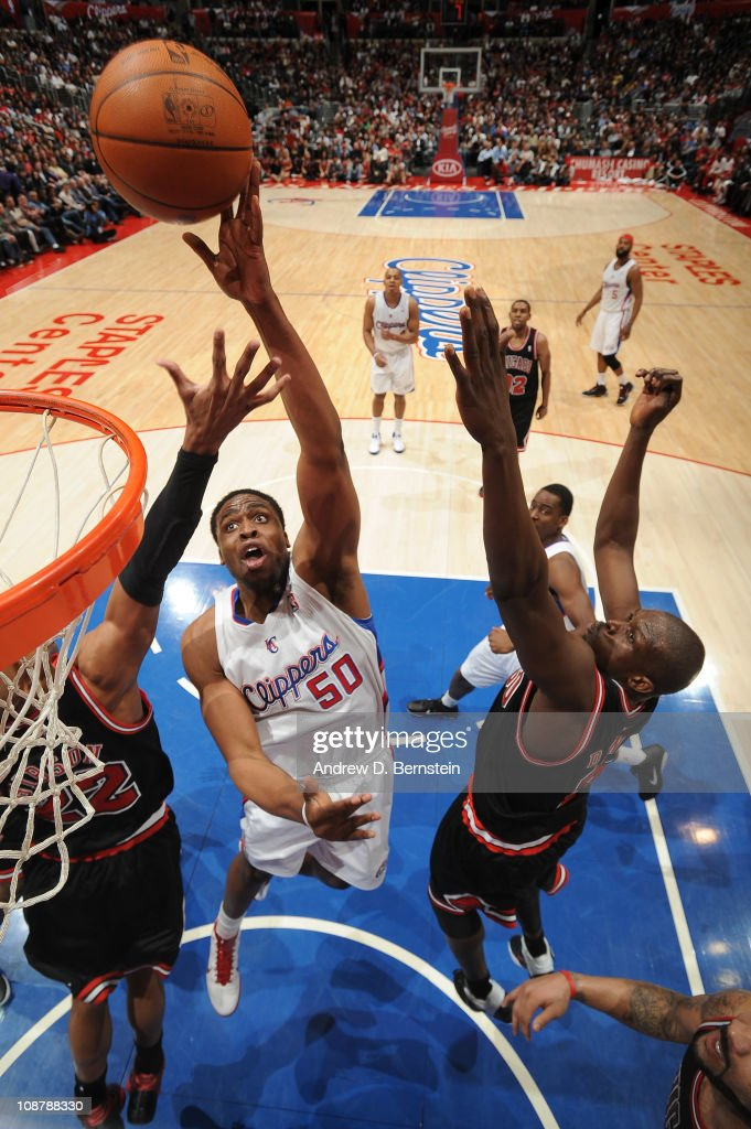 Ike Diogu of the Los Angeles Clippers goes up for a shot against Taj Gibson and Luol Deng of the Chicago Bulls at Staples Center on February 2 2011...